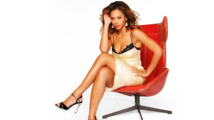 Beyonce Knowles Sitting On A Red Chair Photoshoot