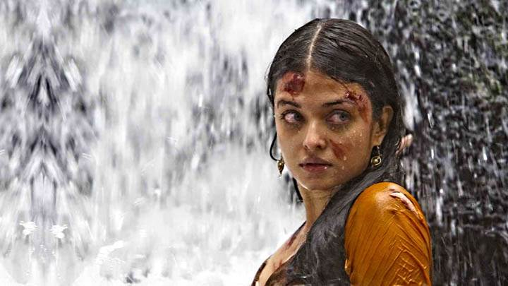 Aish Wallpaper Near Waterfall In Orange Suit