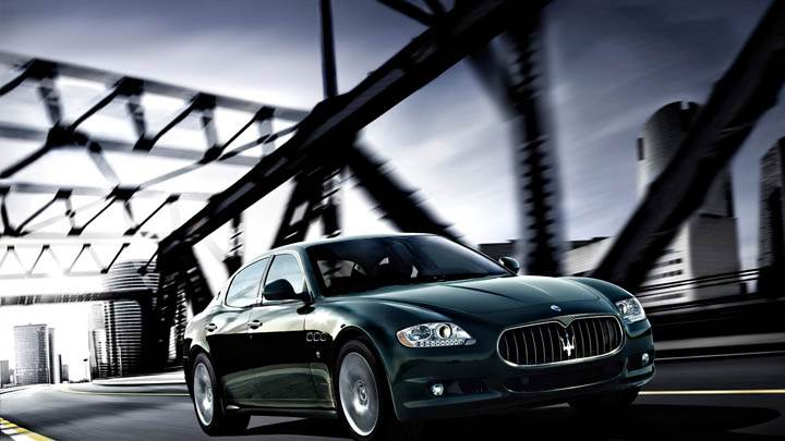 Maserati Quattroporte Running On Bridge