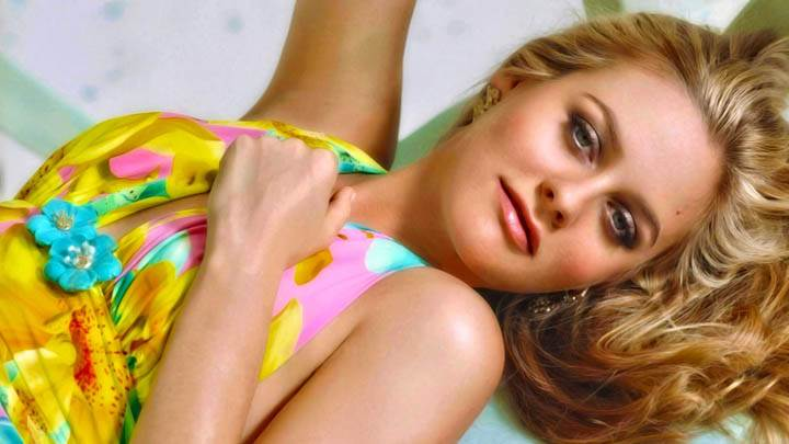 Alicia Silverstone Laying Pose In Yellow Dress
