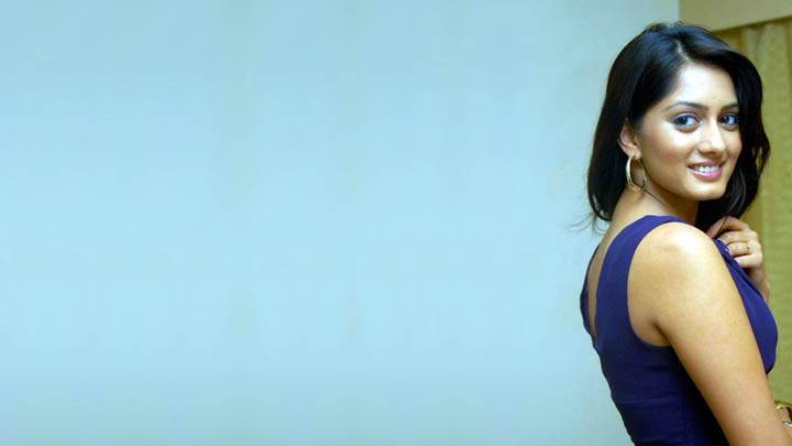 Parvati Vaze Smiling In Blue Dress Side Back Photo