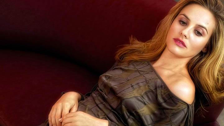 Cute Alicia Silverstone Laying On Red Sofa Sad Face
