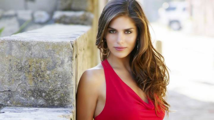 Anahi Gonzales In Red Dress Looking At Camera