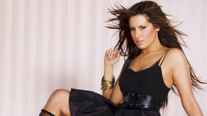 Ashley Tisdale Sitting In Black Dress