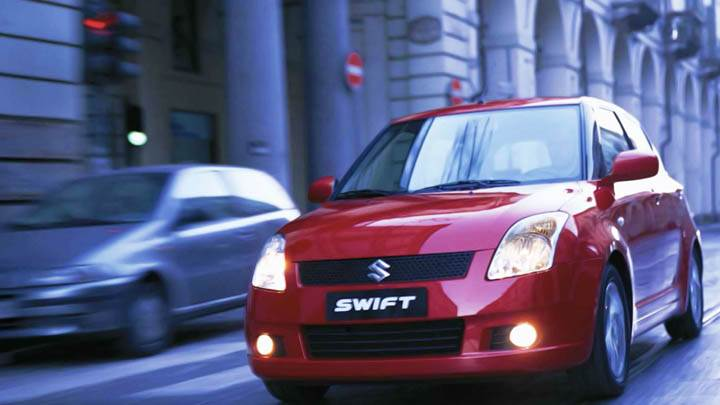 Suzuki Swift Red Sport Car On Street