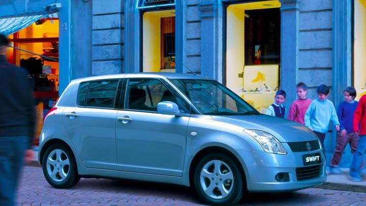 Suzuki Swift Sport Outside Restaurant in Green Blue color