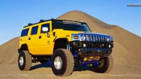 Yellow Hummer Jump From Mountain