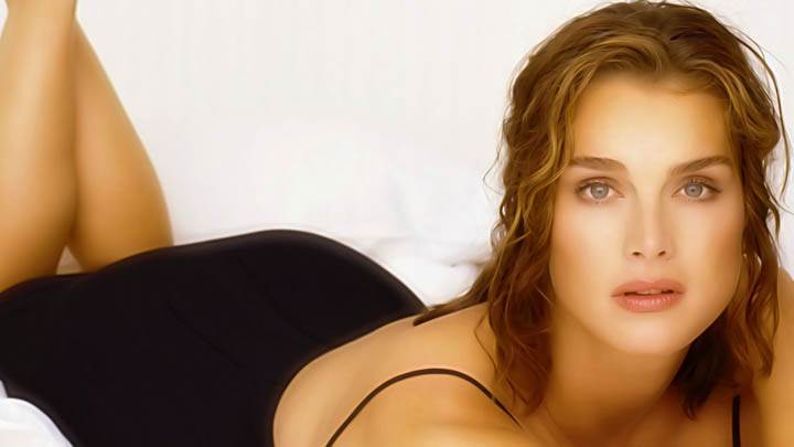 Brooke Shields Laying On Bed Black Dress
