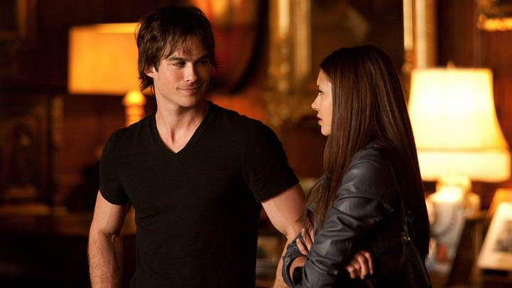 Damon Talking with Elena in Library