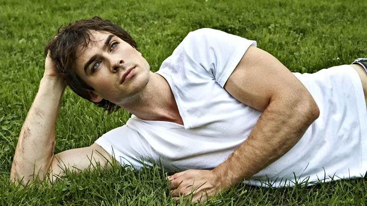 Ian Somerhalder Is Laying In Grass In White Shirt