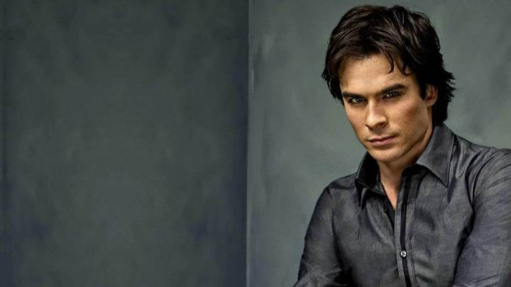 Ian Somerhalder Sitting In Grey Shirt Looking Smart