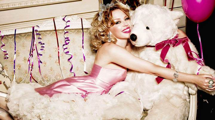 Kylie Minogue Laying On Sofa With Teddy Bear