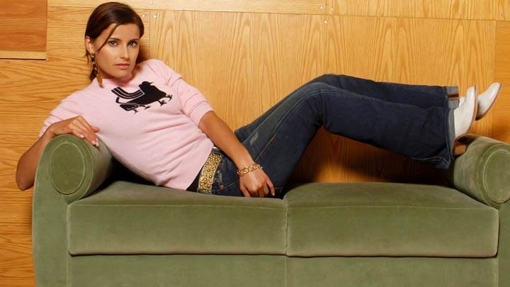 Nelly Furtado Laying Pose On Sofa
