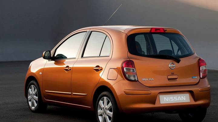 Orange Nissan Micra Tekna 2011 Back Pose