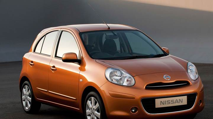 Orange Nissan Micra Tekna 2011 Side Front