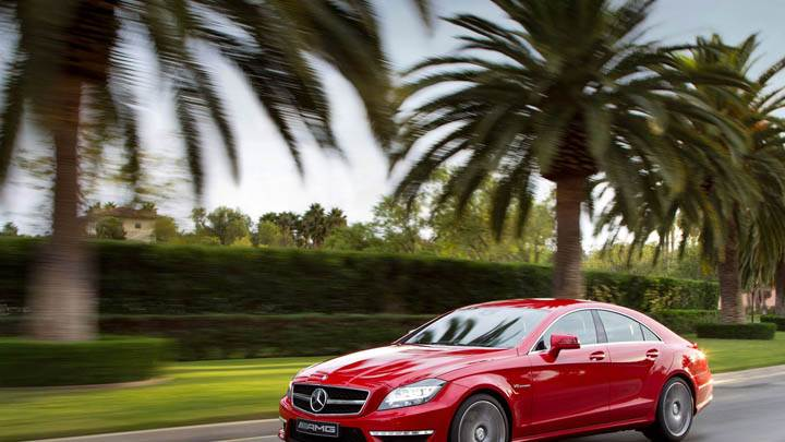 Red Mercedes-Benz CLS63 AMG 2012 Running on Highway