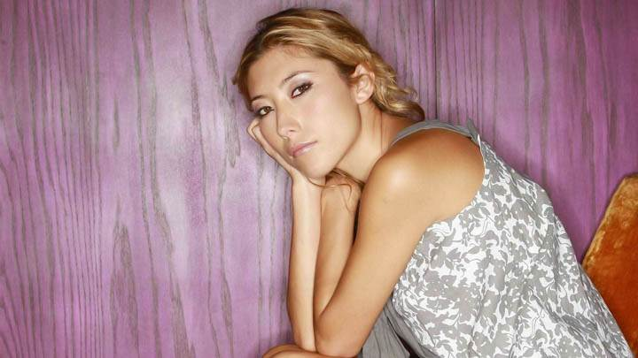 Dichen Lachman Sitting On Chair Thinking Of Something