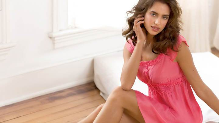 Irina Shayk Sitting in Pink Suit