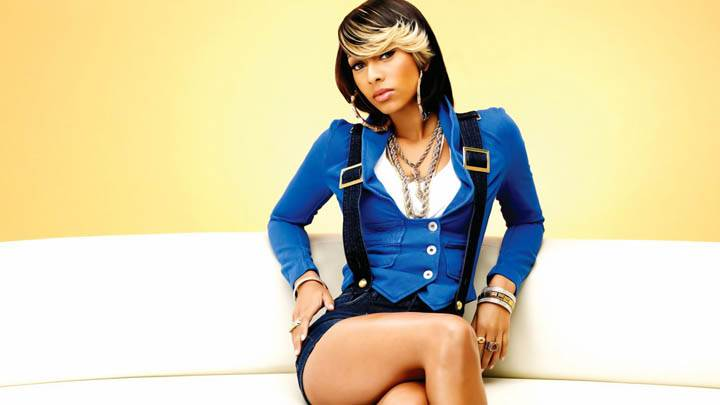 Keri Hilson Blue Jacket Sitting on White Sofa