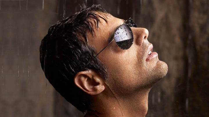 Male Model Wearing Black Goggles in Rain
