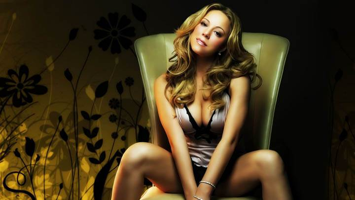 Mariah Carey Sitting On Chair and Smiling