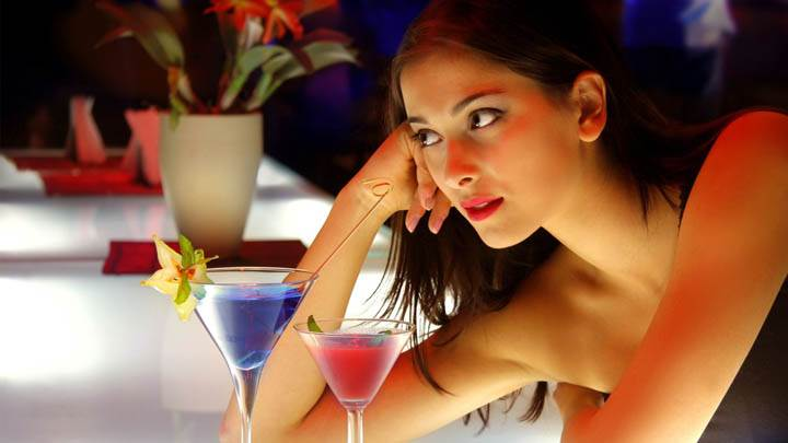 Girl at Bar Counter Looking Somthing