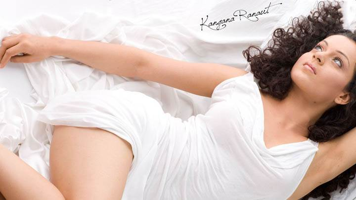 Kangana Ranaut Laying In White Trasnparent Dress