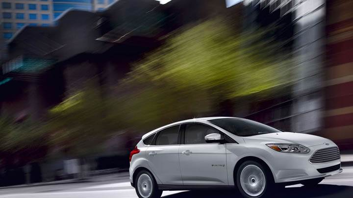 White Ford Focus EV Running Shoot