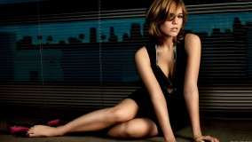 Mandy Moore Sitting in Black Dress Modeling Pose