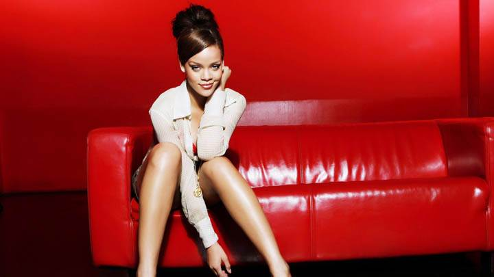 Rihanna Sitting on Red Sofa