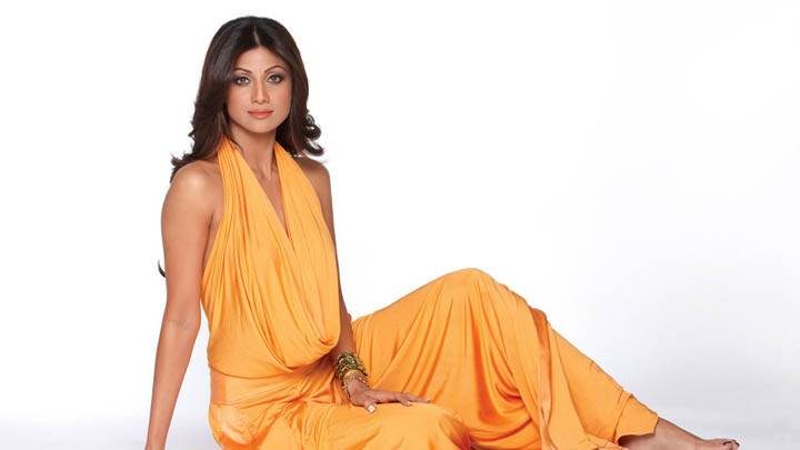 Shilpa Shetty Sitting in Orange Dress