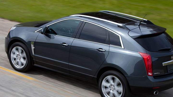 Cadillac 2011 SRX Running on Street