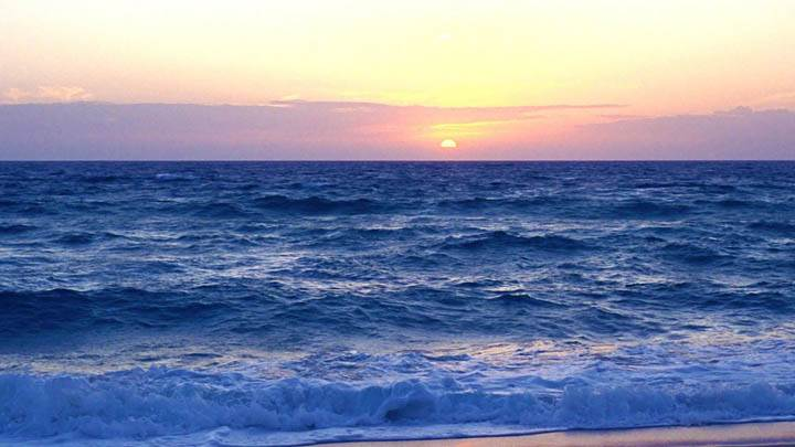 Beach With Sunset And Waves Of The Atlantic Ocean