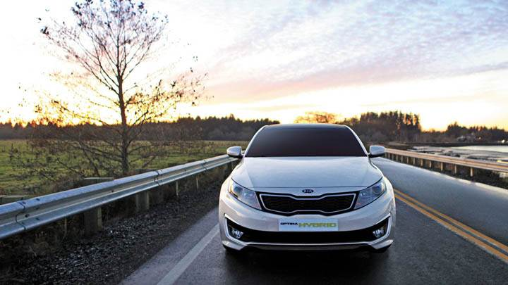Front Pose of Kia Optima Hybrid On Highway