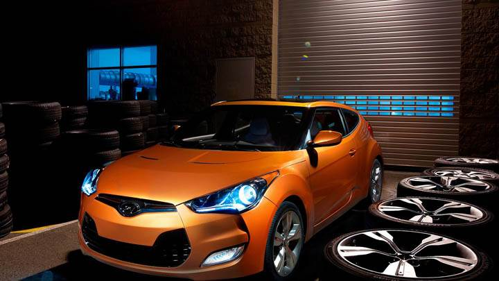 Hyundai Veloster in Garage with Lots of Tyres