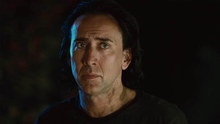 Nicolas Cage In Night Outside House