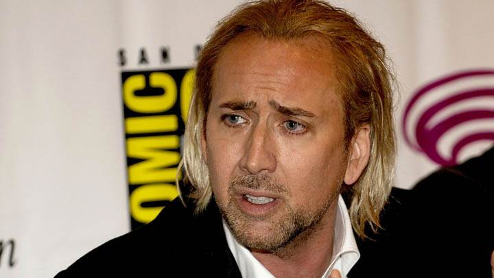 Nicolas Cage Looking Side In Black Coat