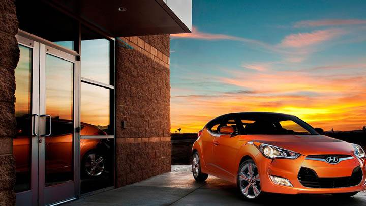 Orange Hyundai Veloster Outside House