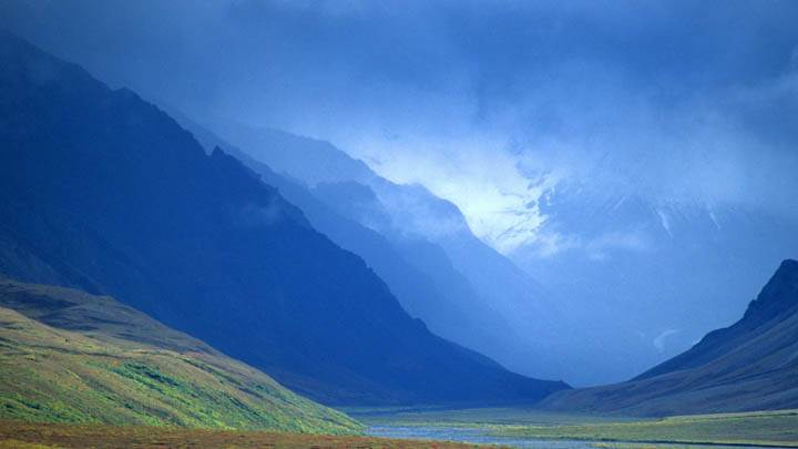 Passing Storm Clouds Lift to Reveal a Colorful Arctic Valley