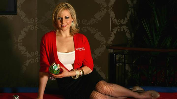 Abi Titmuss Sitting On A Poker Table In Red Dress