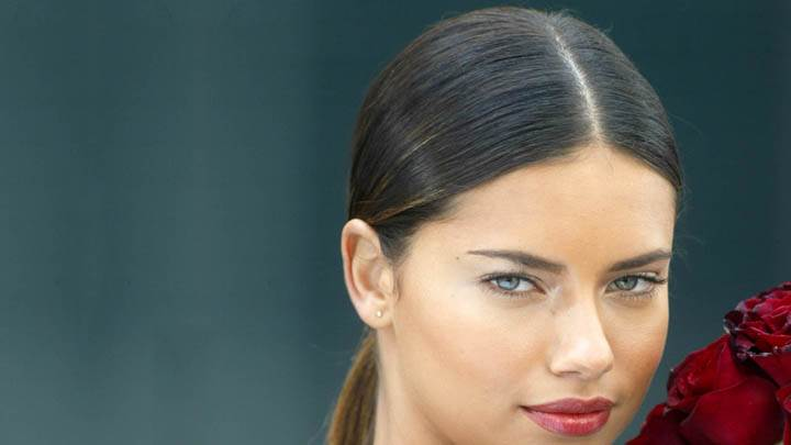 Adriana Lima With Red Roses And Face Closeup