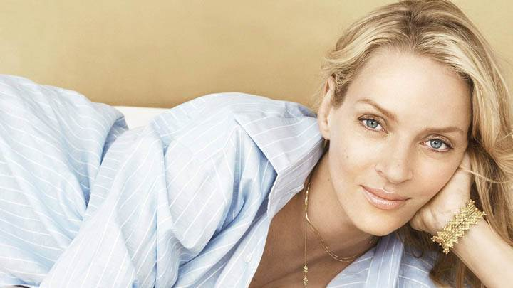 Laying Pose Uma Thurman Smiling In Blue Shirt