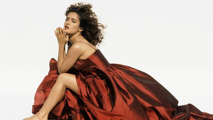 Salma Hayek – Sitting Modeling Pose In A Brown Dress