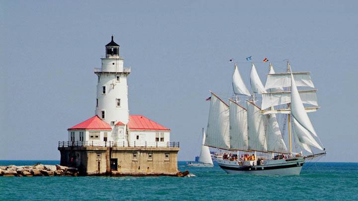 Tall Ship Windy Sails Past the Chicago Harbour Lighthouse