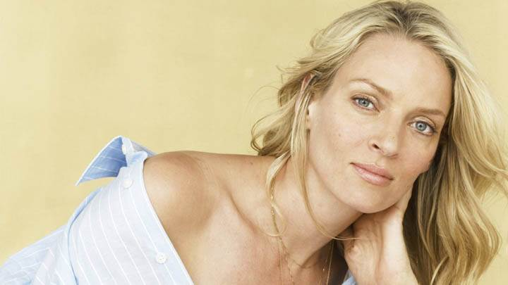 Uma Thurman Smilig In Blue Shirt