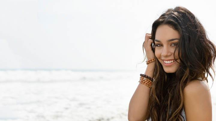 Vanessa Hudgens Smiling Laying Pose On Beach