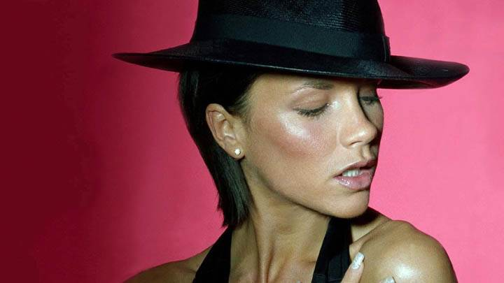 Victoria Beckham Wearing Black Hat Pose