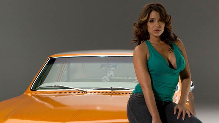 Vida Guerra Sitting Pose On Car In Green Top N Jeans
