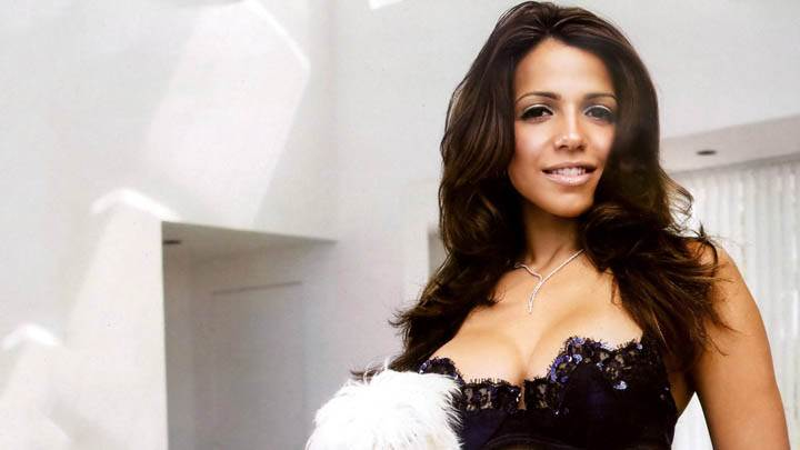 Vida Guerra Smiling In Modeling Pose In Bedroom