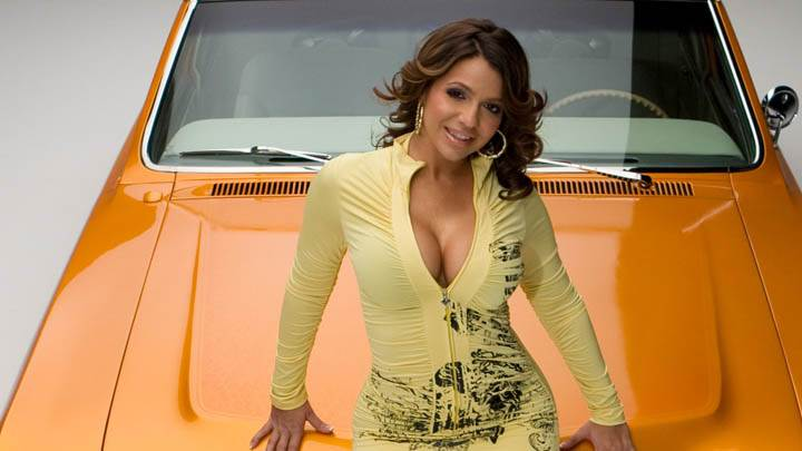 Vida Guerra Smiling Sitting Pose On Yellow Car